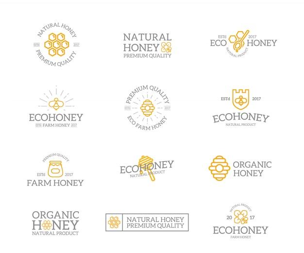 Zestaw kombinacji logo miodu i pszczoły.