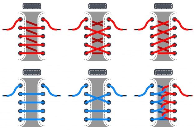 Zestaw koronek w kolorze czerwonym i niebieskim. plany wiązania sznurowadeł odizolowywających na białym tle.