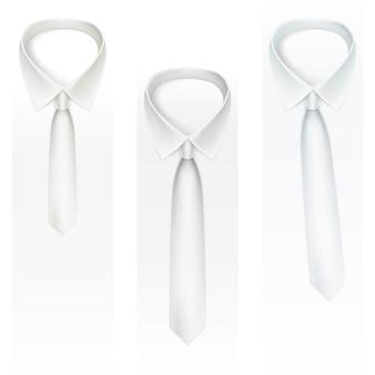 Zestaw krawatów na jasnym tle.