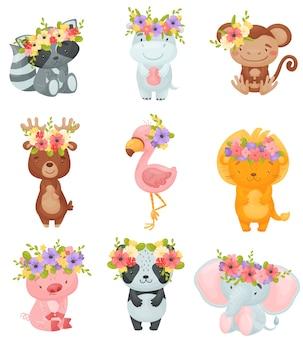 Zestaw kreskówek zwierząt z wieńcami kwiatów na głowach