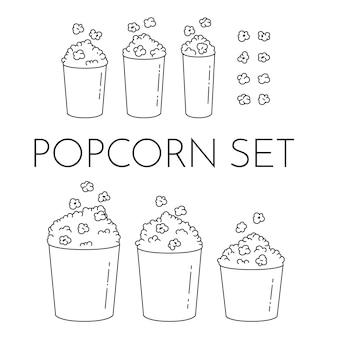 Zestaw kubków z popcornem i jądra pływające pod wiadro. różni rozmiary popkornu pudełka odizolowywający na białym tle. nowoczesny styl linii. czarno-biały ilustracja wektorowa. zarys elementów