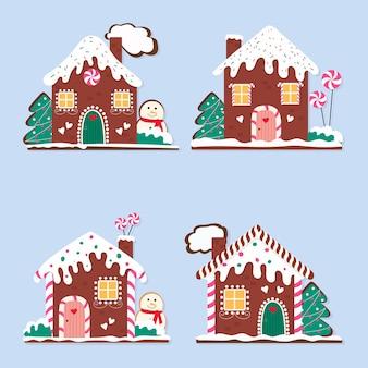 Zestaw ładny świąteczne domy z piernika na niebieskim tle.
