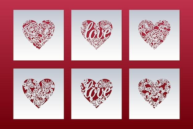 Zestaw laserowo wycinanych kartek z serduszkami w motyle i napisem miłosnym.