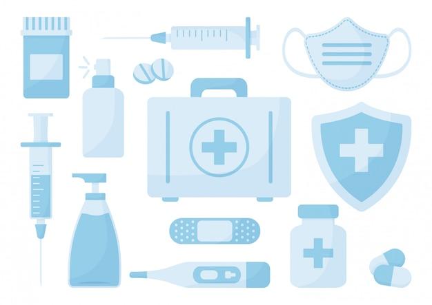 Zestaw leków. środek dezynfekujący, maska medyczna, spray antybakteryjny, mydło, strzykawka, apteczka, pigułki, bandaż, termometr, znak ubezpieczenia medycznego.