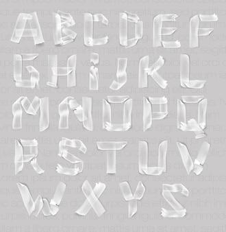 Zestaw liter alfabetu samoprzylepnej przezroczystej taśmy.
