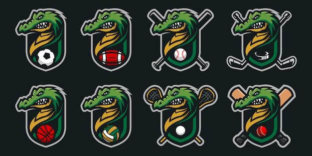 Zestaw logo maskotka głowy krokodyla logo maskotki drużyny sportowej.