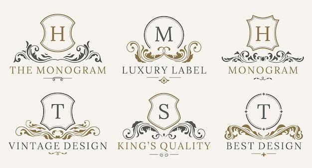 Zestaw logotypów retro royal vintage shields. wektor kaligrafia luksusowe elementy projektu logo.