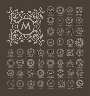 Zestaw luksusowych, prostych i eleganckich wzorów niebieskich monogramów