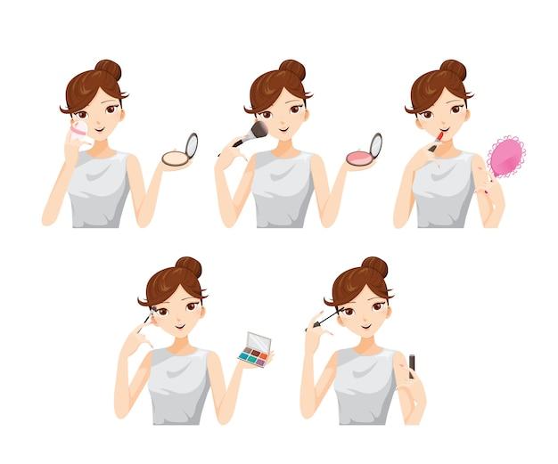 Zestaw młoda kobieta robi z kosmetyków