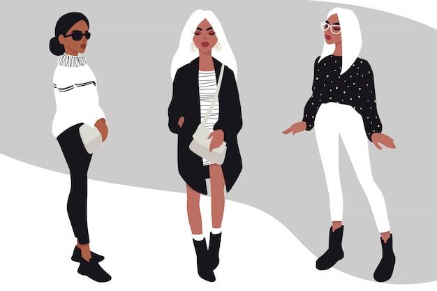 Zestaw młodych kobiet. stylowe dziewczyny w modne ubrania na białym tle.