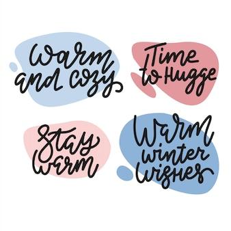 Zestaw modnych odręcznych napisów na temat świąt i ferii zimowych: czas się przytulić, ciepło i przytulnie, zachowaj ciepło, ciepłe zimowe życzenia