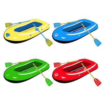 Zestaw nadmuchiwanych łodzi gumowych w różnych kolorach na białym tle