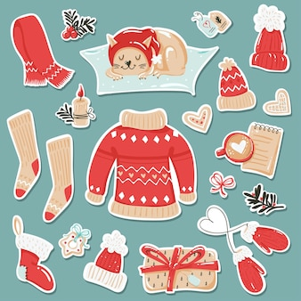 Zestaw naklejek z przytulnymi zimowymi ubraniami i przedmiotami.