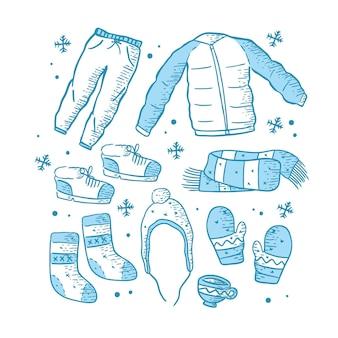 Zestaw narysowanych zimowych ubrań i niezbędnych rzeczy