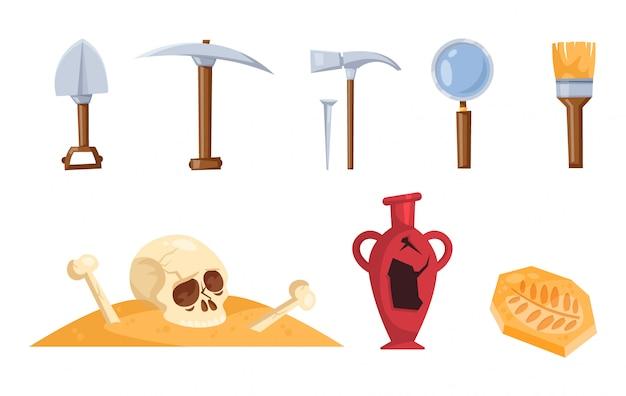 Zestaw narzędzi archeologa. czaszka i kości w piasku.