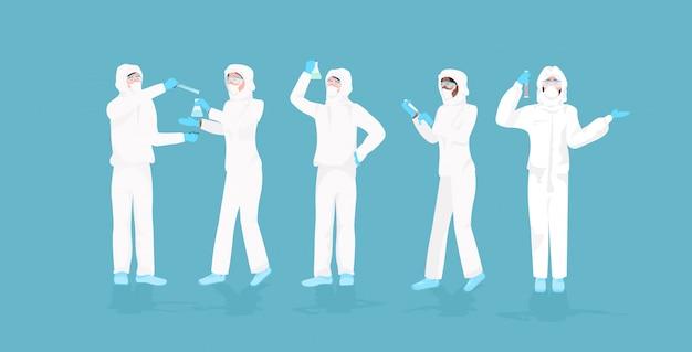 Zestaw naukowców w białych garniturach, trzymając probówki