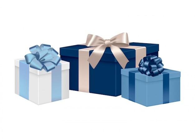 Zestaw niebieskich pudełek z satynowymi kokardkami i wstążkami.