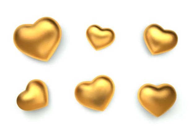 Zestaw niesamowitych realistycznych złotych serc, na białym tle.