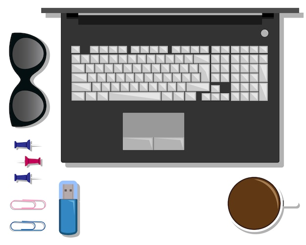 Zestaw papeterii na stole z laptopem.