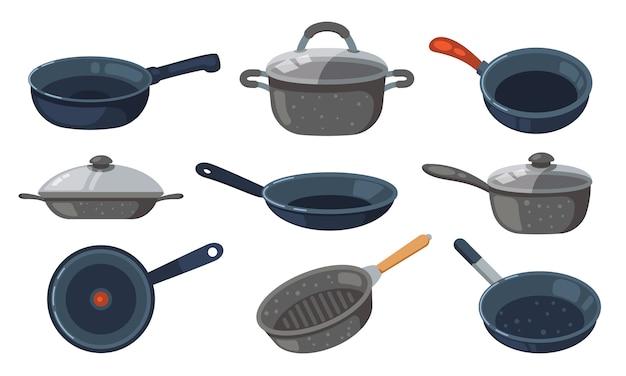 Zestaw patelni. kuchenni garnki i różne niecki odizolowywający na białym tle.