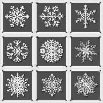 Zestaw pięknych papierowych płatków śniegu.