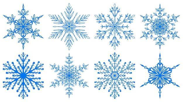 Zestaw pięknych świątecznych płatków śniegu w kolorze niebieskim, na białym tle