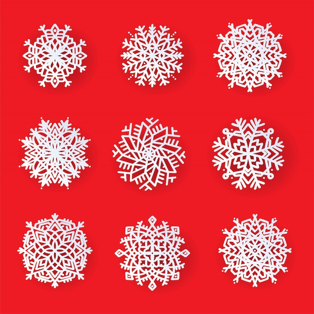 Zestaw pięknych wzorzystych płatków śniegu wycinanych laserowo. szablon świątecznych, noworocznych dekoracji wzorów. elementy na święta nowego roku