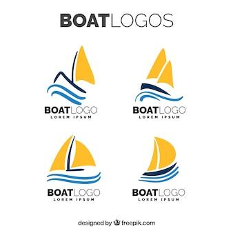 Zestaw płaskich logo łodzi z pomarańczowymi żaglami