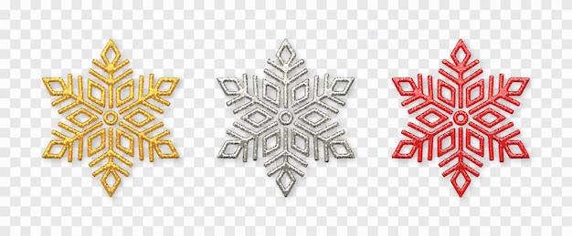 Zestaw płatki śniegu. musujące złote, srebrne i czerwone płatki śniegu z brokatową teksturą na przezroczystym tle.