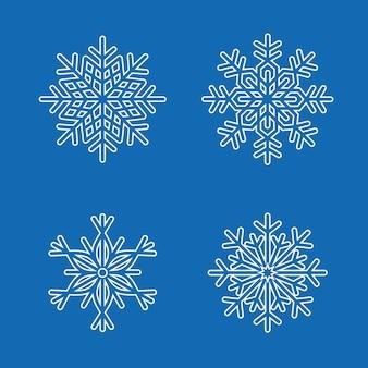 Zestaw płatki śniegu na białym tle na niebiesko
