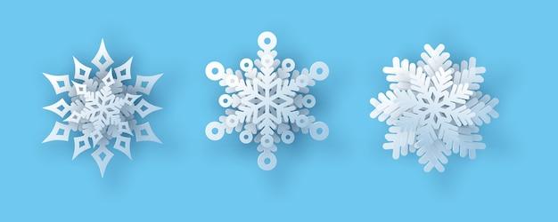 Zestaw płatków śniegu. ilustracja wektorowa realistycznego płatka śniegu papieru.