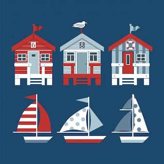 Zestaw plażowych chat i łodzi.