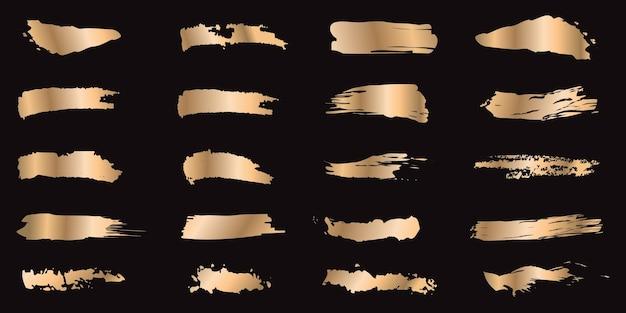 Zestaw pociągnięć atramentem złota na białym tle