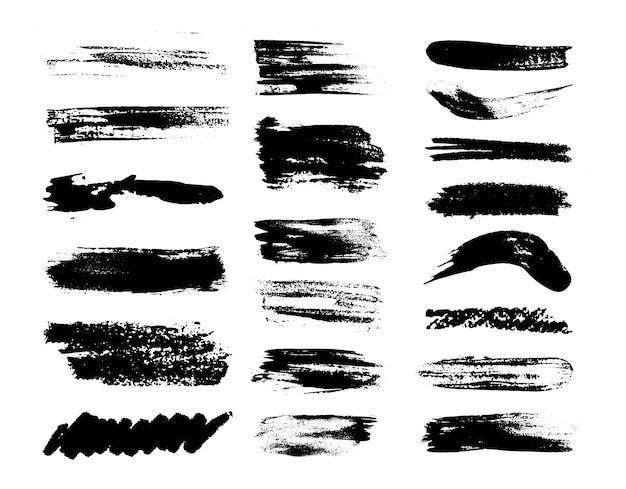 Zestaw pociągnięć pędzlem grunge. na białym tle sylwetki brudnej cieczy. zestaw ilustracji.