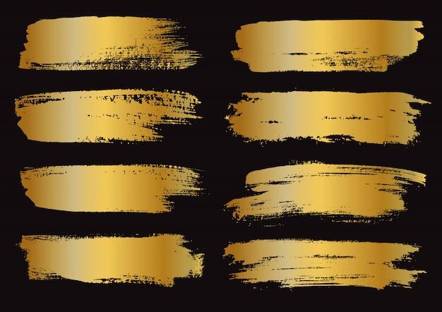 Zestaw pociągnięć złotej farby