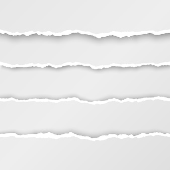 Zestaw podartych pasków papieru