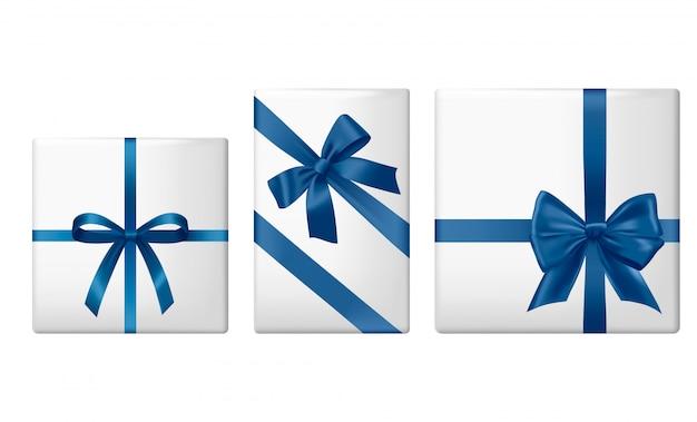 Zestaw prezentów z satynowymi wstążkami i różnymi kokardkami.