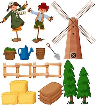 Zestaw przedmiotów rolniczych ze strachami na wróble i wiatrakiem