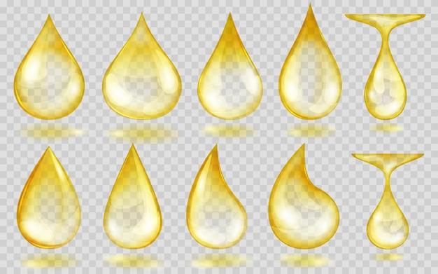 Zestaw przezroczystych kropli wody lub oleju w żółtych kolorach w różnych kształtach, na przezroczystym tle. przezroczystość tylko w formacie wektorowym