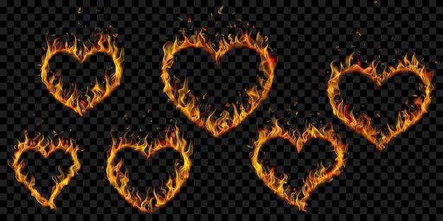 Zestaw przezroczystych płomieni ognia w kształcie serca na przezroczystym tle. do wykorzystania na ciemnych ilustracjach. przezroczystość tylko w formacie wektorowym