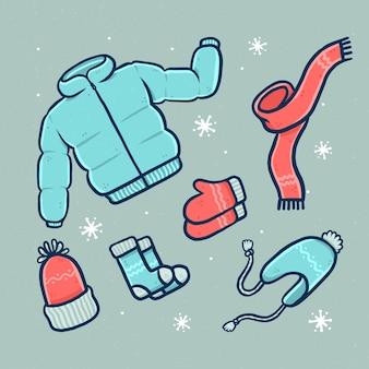 Zestaw przytulnych zimowych ubrań i niezbędnych akcesoriów