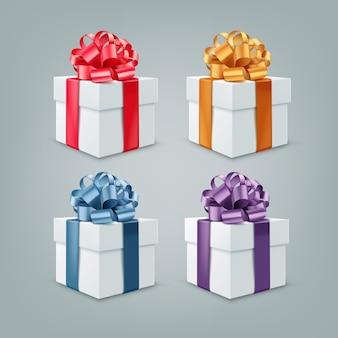 Zestaw pudełek prezentowych z kolorowymi wstążkami i dużymi kokardkami