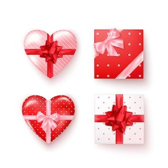 Zestaw pudełek z jedwabnymi kokardkami w realistycznym widoku z góry. pudełka w kształcie kwadratu i serca. na białym tle