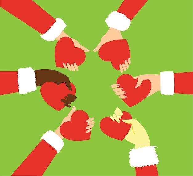 Zestaw rąk świętego mikołaja trzymających czerwone serce i ręce dzieci na zielonym tle