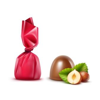 Zestaw realistycznych cukierków z czekolady mlecznej z orzechami laskowymi w ciemnoróżowym błyszczącym opakowaniu z folii z bliska na białym tle na białym tle
