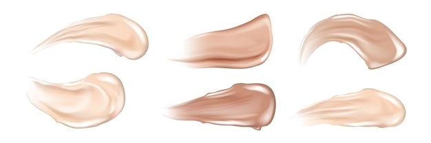 Zestaw realistycznych pociągnięć kremem do skóry. kolekcja narysowanego w stylu realizmu brązowego płynnego naturalnego korektora lub smug balsamu przeciwsłonecznego. ilustracja podkładu do makijażu i produktów do pielęgnacji skóry.