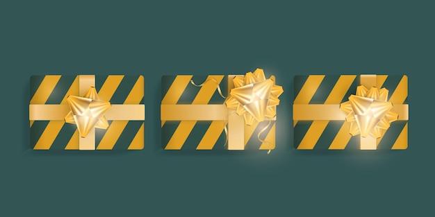 Zestaw realistycznych pudełek prezentowych z zielonymi i żółtymi paskami, złotymi wstążkami i kokardą. ilustracja wektorowa.