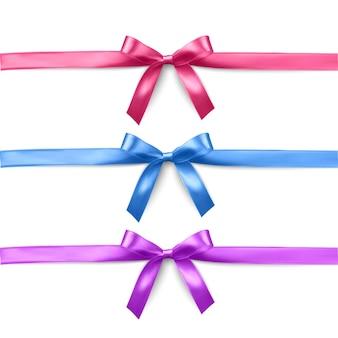 Zestaw realistycznych różowych, fioletowych i niebieskich wstążek i kokardek