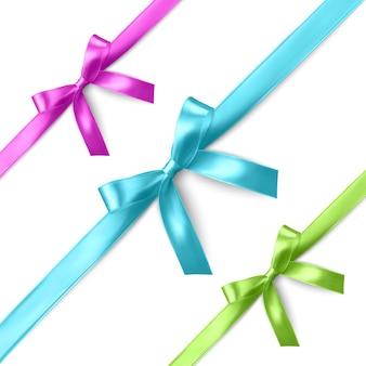 Zestaw realistycznych różowych, niebieskich i zielonych wstążek i kokardek