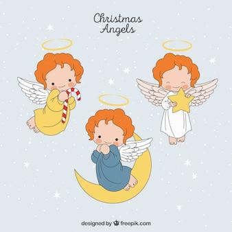 Zestaw ręcznie rysowane boże narodzenie anioły